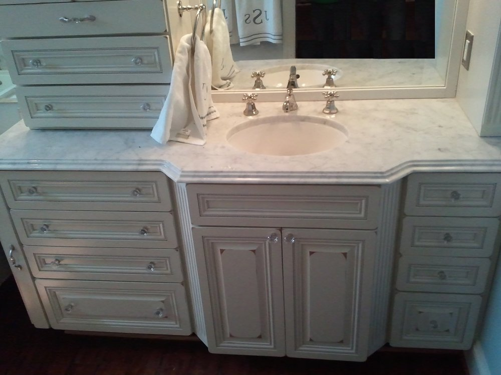 white vanity with marble top