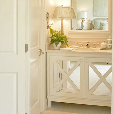 white vanity with glass cabinet fronts