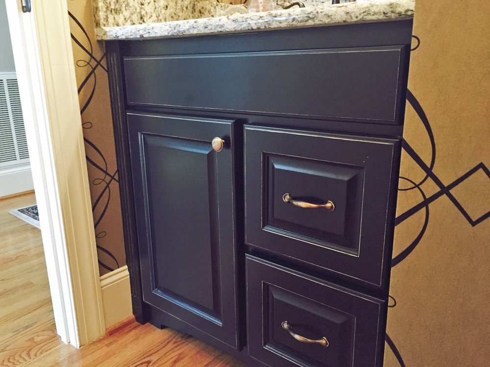 black distressed vanity with false-front drawer