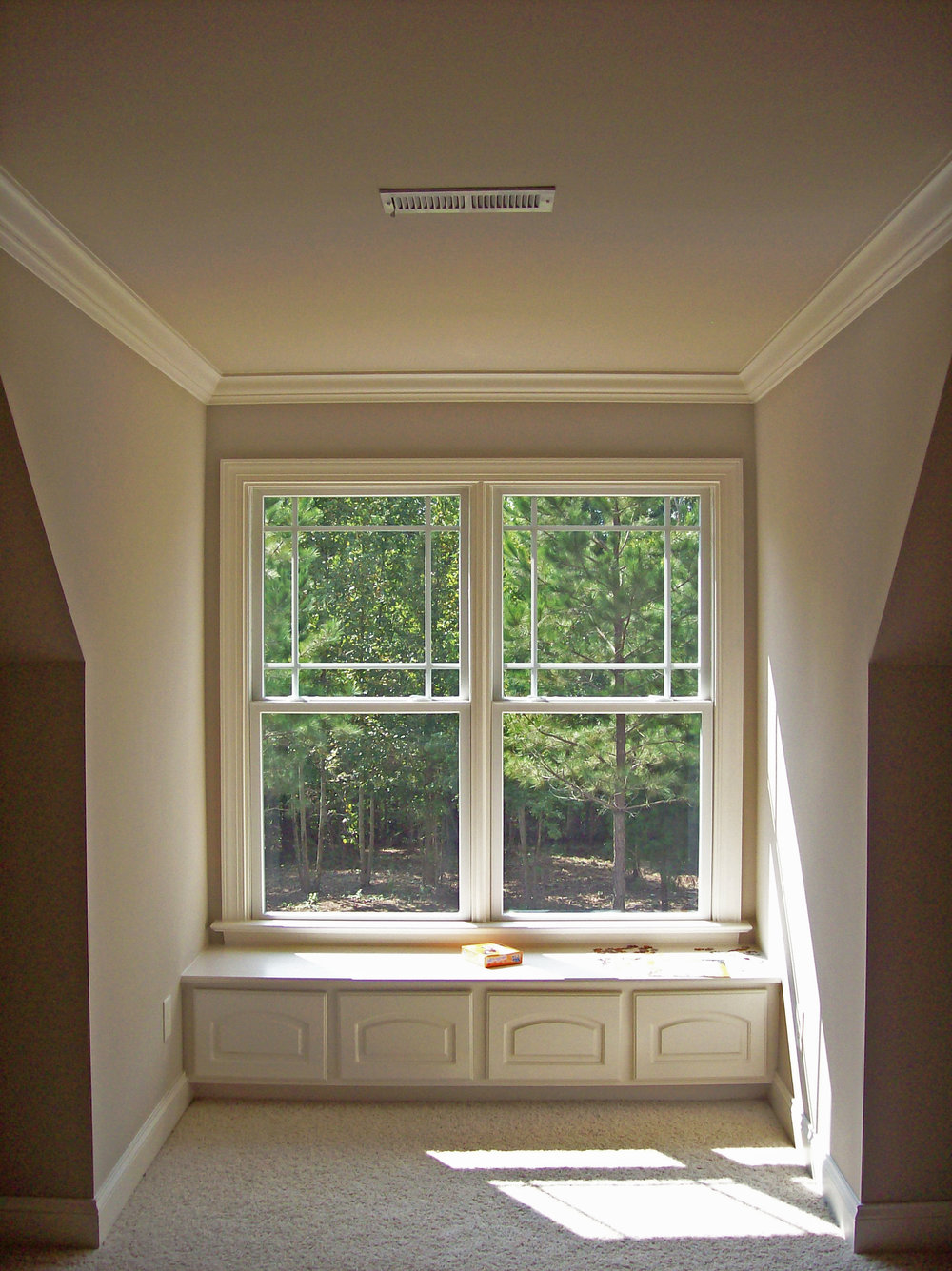 Window Seat with Arched Raised Panel Doors