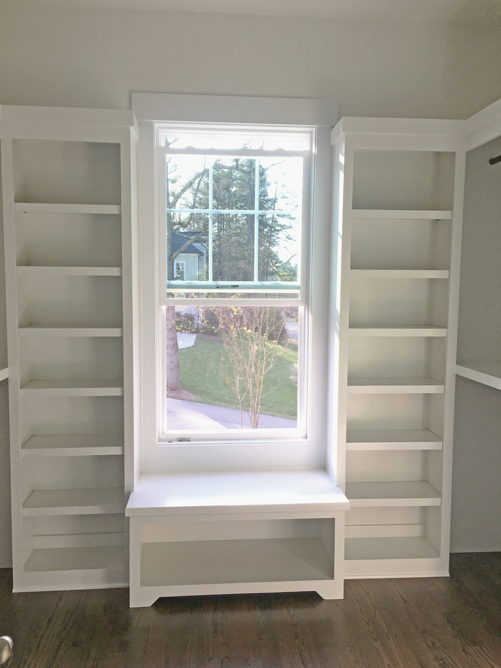 Custom Open Cubbie Window Seat with Toe Kick Detail and Side Bookcases