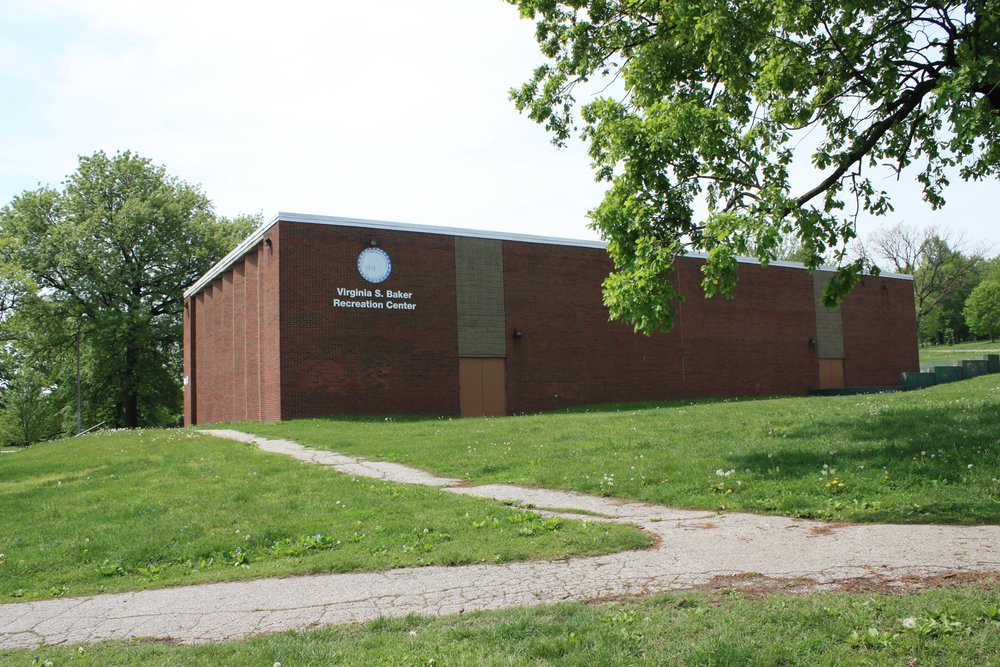 The Virginia Baker Recreation Center The Virginia S. Baker Recreation Center, constructed in 1974, is a hub of activity with a year-round schedule of programs. The Recreation Center is located inside the park at 2601 E. Baltimore Street (near Luzerne and Baltimore). The center includes a large multi-purpose room, gymnasium, game room, meeting room, kitchen, and computer lab. Activities have included Salsa classes, Yoga, Volleyball, Karate, Zumba, Cooking classes, Youth Basketball, Pinata making and much more.  Please call 410-396-9156 or visit their website for more information on a current schedule of activities.