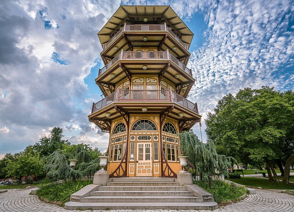 The Pagoda   The known as the Pagoda because of its oriental architectural appearance, the design was intended to reflect the bold Victorian style of the day. From the top of the tower one can view downtown, Baltimore's many neighborhoods, the Patapsco River, the Key Bridge and Fort McHenry.  Over time and due to natural decay, vandalism, and lack of maintenance funds, the Pagoda was closed to the public in 1951 when the first of a series of partial renovations was attempted. At one point demolition was proposed as an option but thankfully the 1998 Master Plan for Patterson Park called for the complete restoration of the Pagoda. This project was guided by the Friends of Patterson Park, in partnership with Baltimore City's Department of Recreation and Parks and MANY neighborhood volunteers. Completed in the spring of 2002, the Pagoda now stands as an iconic structure for Patterson Park and Baltimore City and signified the renaissance of the community around Patterson Park. It is also the location of many programs and events, such as the Friends of Patterson Park Summer Concerts Series, Audubon's family programs, Tour Dem Parks waterstop, one of the sites of AVAM's Kinetic Sculpture Race obstacles, The Friends' annual Moonlight Pagoda event and much, much more!  The Pagoda is operated, maintained and staffed by The Friends of Patterson Park and volunteers. The Pagoda is open 12 noon to 6 pm on Sundays from mid-April through mid-October.