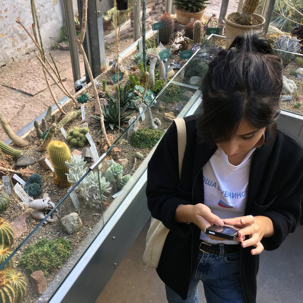 Maria when we visited the the Botanical Garden. She had to keep deleting pictures on her phone to take new ones.
