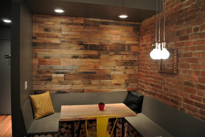 Gray and brown board accent wall in our clients breakfast nook.