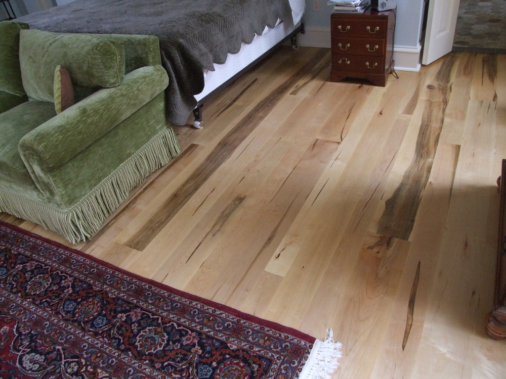 Rustic wormy maple flooring.
