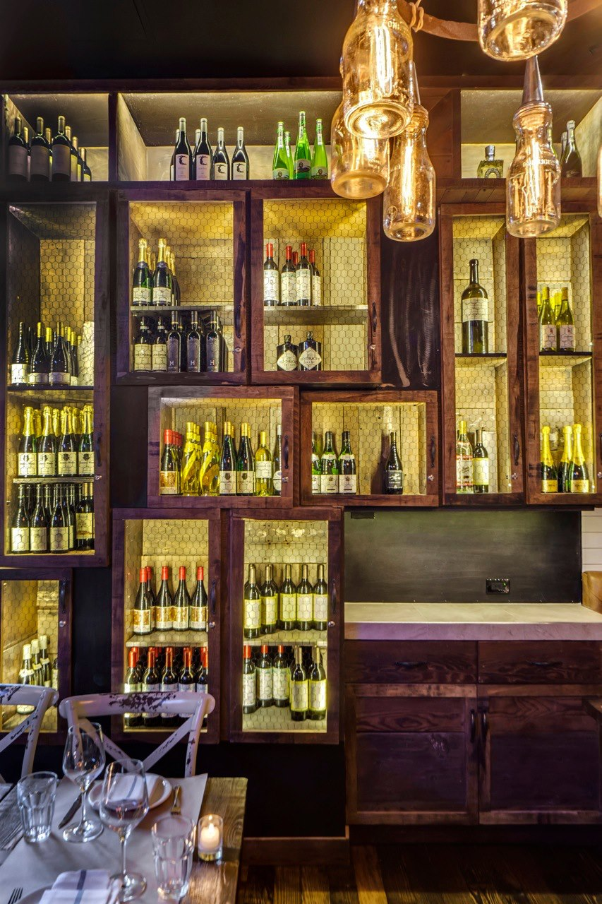 Rustic butternut wine displays for the cocktail bar, Willow Road, in NYC.