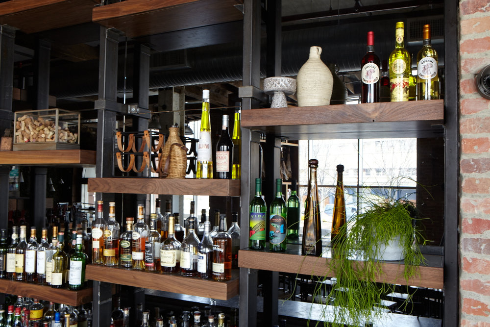Raw steel and walnut shelves for a liquor splay at Toro in NYC.