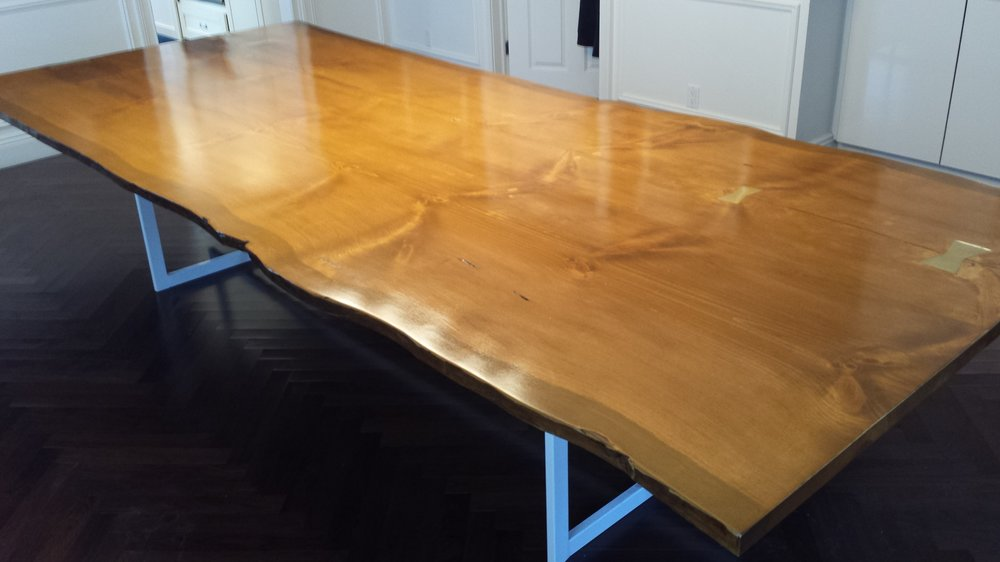 Book matched hard pine live edge dining table with custom power coated steel legs.