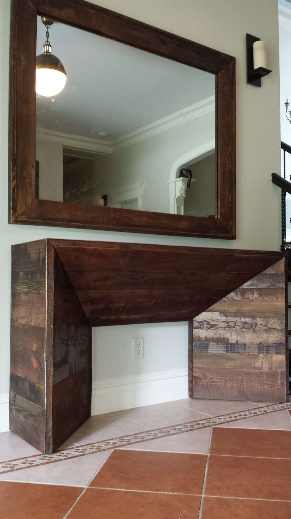 Reclaimed brown board entrance table and mirror.