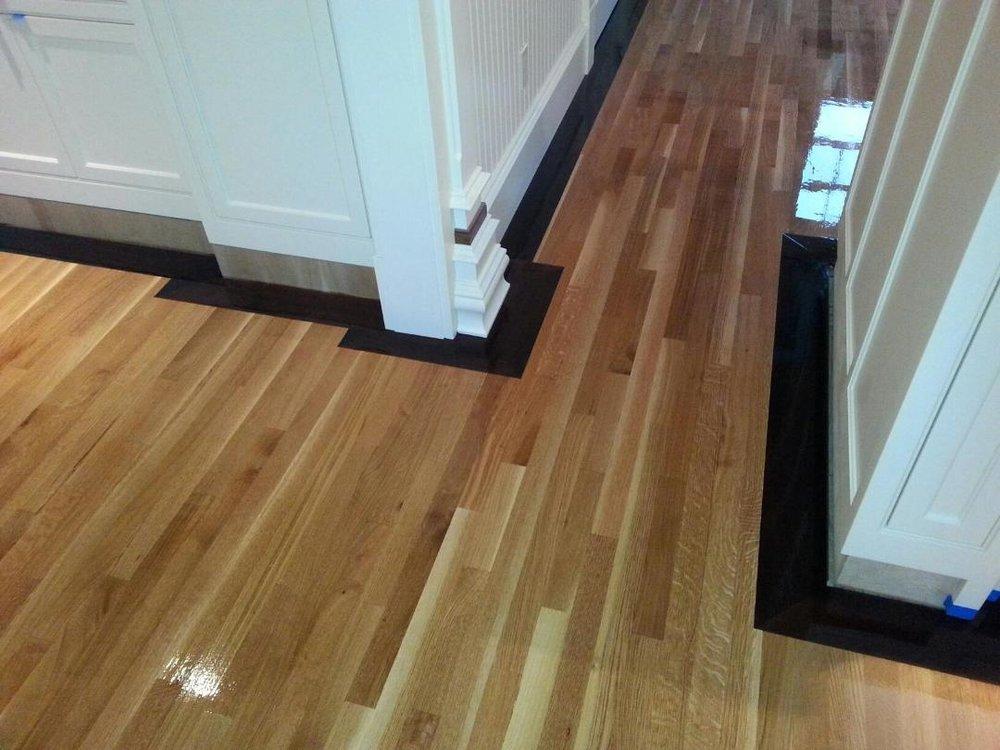 Rift-Sawn-White-Oak-Flooring-With-5quot-Walnut-Border-In.jpg
