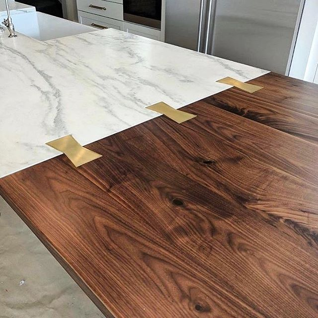 Today's #flashbackfriday is dedicated to one of our favorite countertops ever. The walnut top is joined seamlessly to the marble countertop with our beautiful brass bow ties. Incorporating wood into your design can be sleek and modern, rough and rustic, or a combination of both. The possibilities are endless! | #fbf collaboration with @birgittepearcedesign