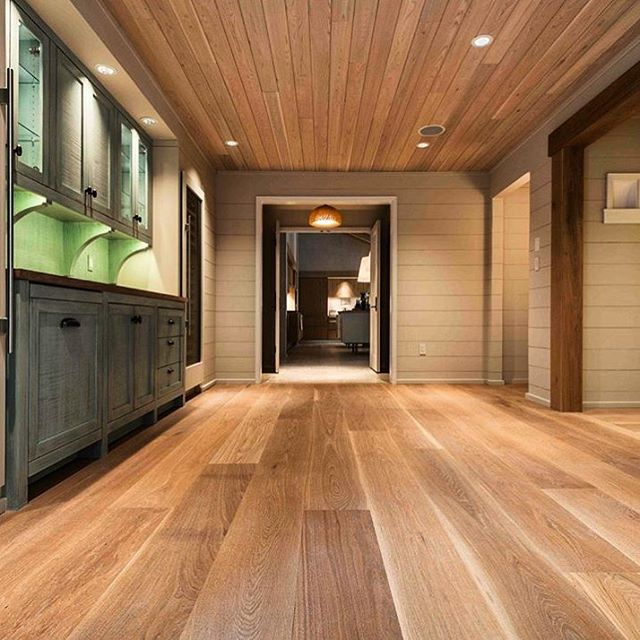 Is there anything better than a White Oak floor? Our Select White Oak provides a clean and consistent look, as it's mostly free of knots and mineral streaks. The light brown heartwood complements a modern or classic vibe and allows for creative design in your space. Click the link in our bio to learn more about our different types of hardwood flooring and find the best fit for your interior design project!
