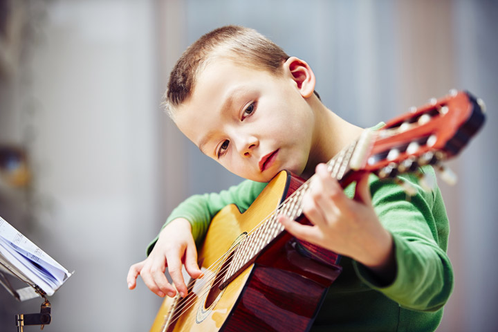 "Between school, sports, homework, and other commitments, it may seem like there is no time to add music lessons to your child's schedule. However, there are a number of surprising ways in which children benefit from studying music. The following are five of the many ways kids benefit from music lessons! 1.              Improved motor skills Learning to play a musical instrument can improve both motor skills and coordination. Because many musical instruments require finely tuned finger and hand movements, fine motor skills and coordination are improved. Likewise, gross motor skills can also improve as students practice the posture and positioning necessary to hold and play an instrument. 2.              Increased IQ A 2004 study done by The University of Toronto found a link between weekly music lessons and increased IQ. Six-year-olds who took weekly music or vocal lessons tested, on average, three IQ points higher than their peers who took other art lessons or no additional lessons at all. This is thought in part to be caused by the increased neural activity that comes with learning music. 3.              Higher test scores Studies have repeatedly shown that students who study music score higher on standardized tests, including the SAT. One report found that students enrolled in music appreciation courses scored 63 points higher on verbal and 44 points higher on math on their SATs than other students. 4.              Cultivate social skills Playing as part of a group or ensemble can help students develop social skills. In addition to interacting with peers, children learn how to adjust their performance as part of the larger ensemble and work together towards a common goal. ""These are the kinds of experiences we have in society,"" says the founder of Music Rhapsody in Redondo Beach, Lynn Kleiner. ""We need more group interaction and problem solving."" 5.              Develops discipline and patience Learning an instrument isn't a skill that is acquired overnight. Learning proper posture, position, and instrument care must all be mastered before any playing even begins; likewise, students must learn to carve out time each day for practice. Because an instrument can take years to master, students learn patience along with their instrument of choice."