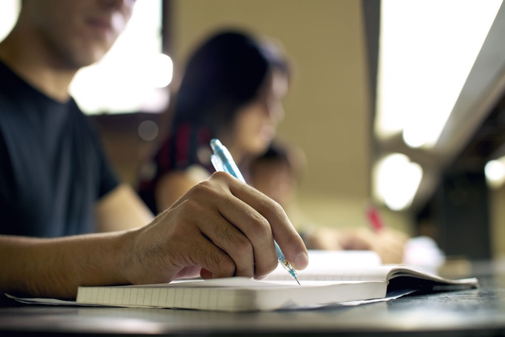 "Not only does notetaking help a student go back and study class material at home and review for tests, but it also helps him or her learn better in class. However, many students are never taught how to take notes effectively. The following tips will help your child better notes in class!   1.     Take notes by hand. While some teachers now allow students to use laptops, iPads, or other forms of technology in class, this can actually hurt one's ability to take notes effectively. A study by Princeton University found that students who took notes by hand actually remembered and retained information better than classmates who used laptops. This happens because when using technology, students type what they hear verbatim without processing it. Students who write notes by hand condense the information as they write, picking out the most relevant information to retain. 2.     Pick and choose what to focus on. Focus on the words and concepts that are most important to the lesson. Likewise, prioritize recording new information over things you already know. This keeps notes from becoming cluttered and allows the student to key in on concepts he or she wants to retain. 3.     Use the ""question, answer, evidence"" model. After focusing in on the most important information from the lecture, encourage your student to write notes in the form of questions. Then, have him or her answer the question as well as provide examples. For example, a class discussion over Romeo & Juliet could include the question, ""What is the central theme?"" with the answer ""consequence of holding grudges"" followed by two to three specific examples. 4.    Create one's own shorthand. Even fast writers may only be able to record every other word from a lecture. While writing down every word may not be necessary, developing one's own shorthand can help to take notes faster and record more information. Using abbreviations like wd or cd for would or could are quick ways to take notes faster. However, make sure your student will still be remember and read the abbreviations! 5.                        6.  Ask for help if necessary. Taking notes is a learned skill; it takes repetition and practice in order to effectively record lectures in class. If your student is having trouble keeping up while taking notes, have him or her ask the teacher for tips and pointers for their specific class. Some teachers will even allow students to use a recording device in order to review the exact lecture after class. Likewise, don't forget to encourage them to ask classmate for help. Sharing notes – not simply copying someone else's work – allows them to get multiple perspectives on the same lesson."