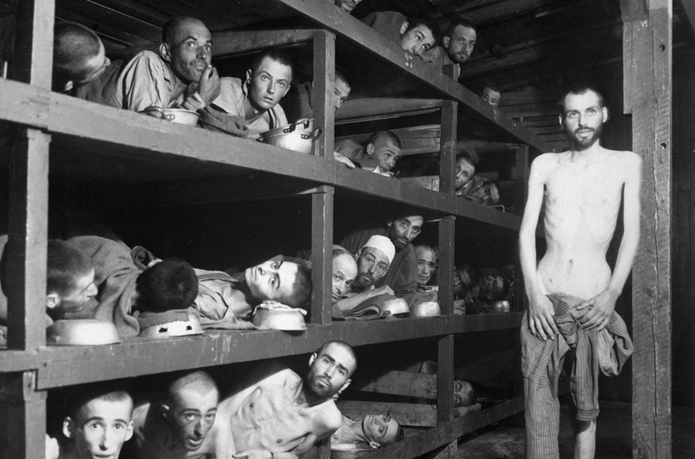 Jewish slave laborers in the Buchenwald concentration camp near Jena, Germany on April 16, 1945. Second row, seventh from left is Elie Wiesel.