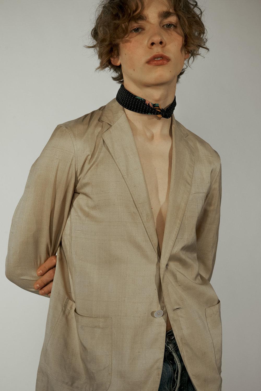 Quinn wears Vest Vintage Ralph Lauren Scarf Fendi