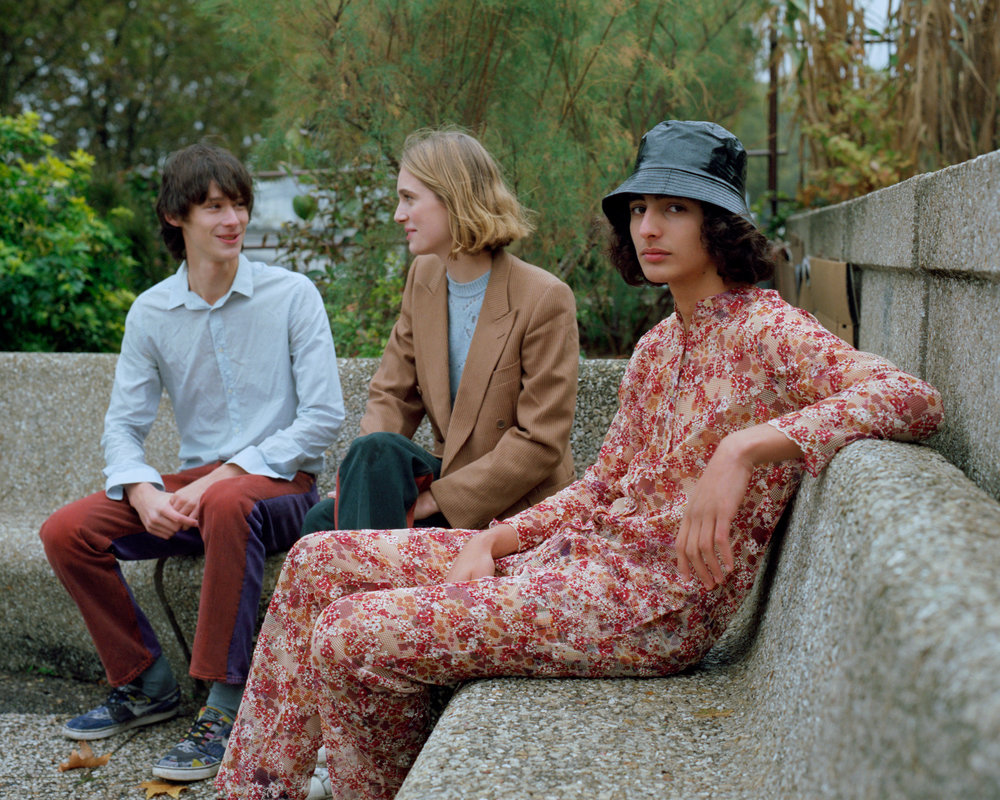 Charles is wearing Shirt  Vintage    Pants  Bless  Julie is wearing Blazer  Vintage    Jumper  Raf Simons    Trousers  Bless  Tomas is wearing Jumpsuit  Bless    Hat  Stylist's own