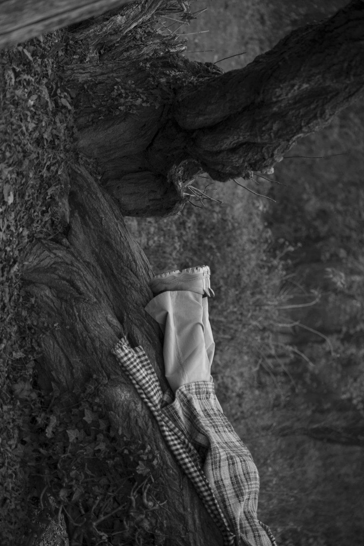 Trousers  DRIES VAN NOTEN  Jacket  JW ANDERSON  Scarf  ACNE STUDIOS  Shoes  EYTYS