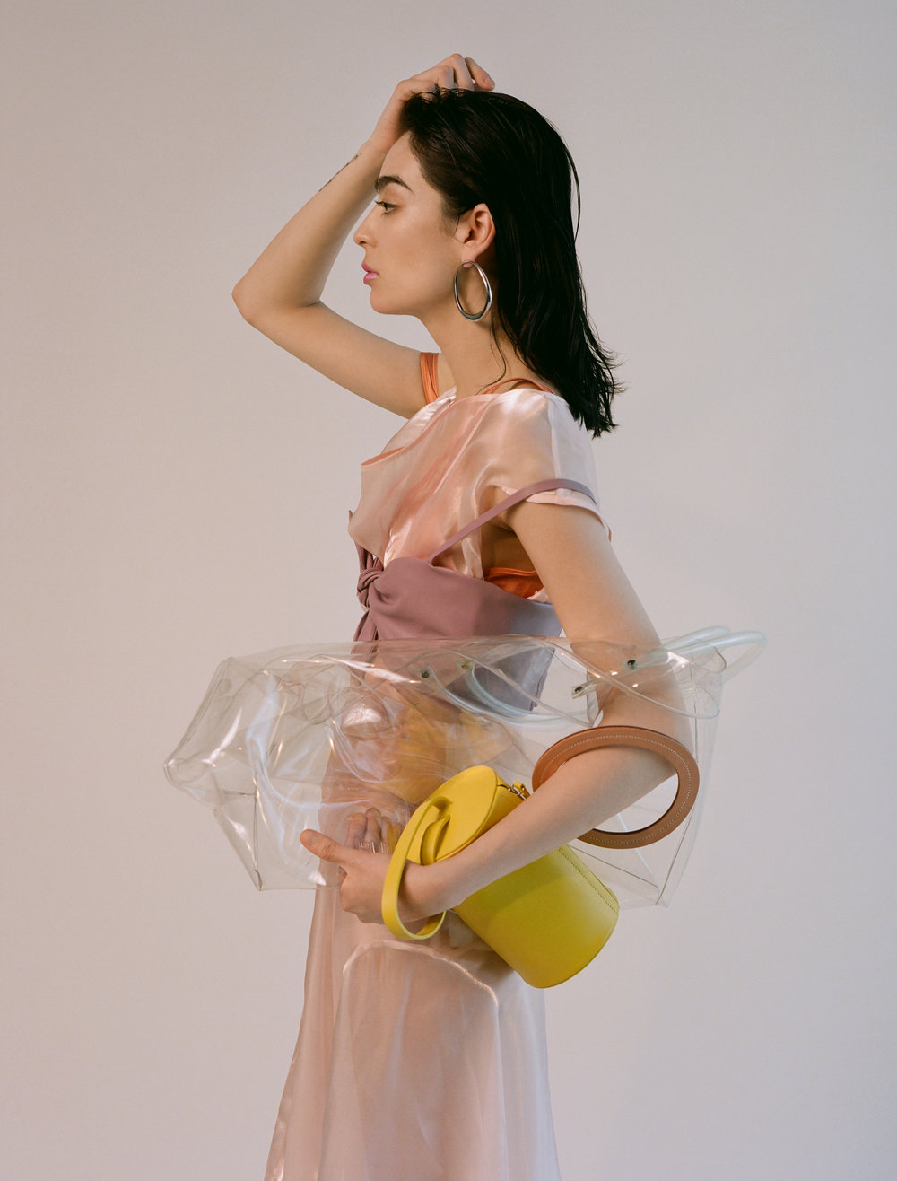 Organza dress  ADEAM    Silk top underneath  BASERANGE    Bow bra  NANUSHKA   Earrings  Stylist's Own    Transparent bag  BUILDING BLOCK    Yellow bag  BUILDING BLOCK