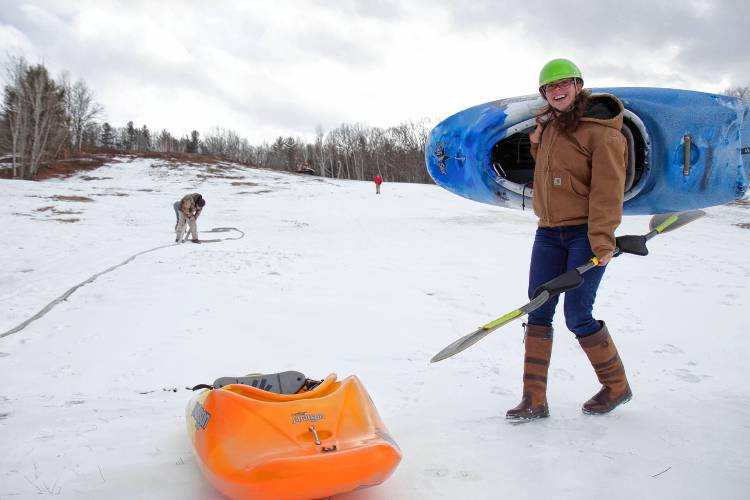 The author's friend and volunteer Orli Gottlieb finishes up a couple test-runs kayaking down the Veterans Memorial Recreation Ski Area in Franklin on Friday, the day before the Boat Bash Snow Crash event. Elodie Reed—Concord Monitor