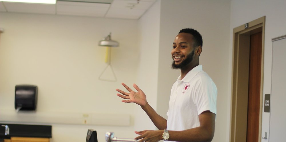 "Pictured: Bryon Ford (SEED DC '12, Morehouse '16), came back to SEED DC as a student life counselor and teacher to ""pay his tithes"" to his community."