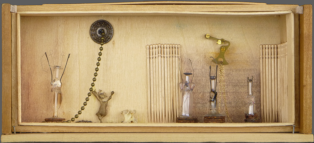 "Free Association, 2014, 9.5""w x 4.25""h x 3.5""d. Mixed media, including wood, various metals, bronze spill, glass, bone, lightbulb filaments, $210."