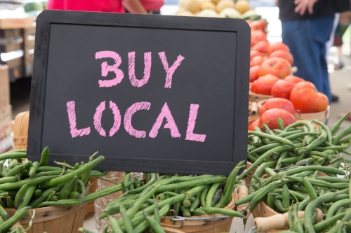 buy local written in chalk with vegetables