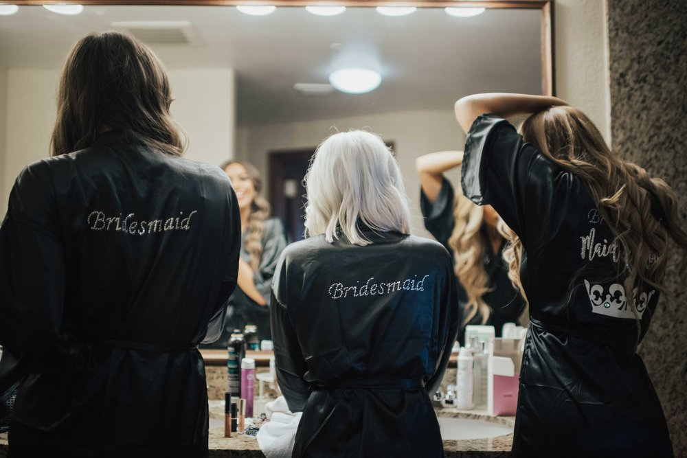 All of my bridesmaids word black silk robes with their names stitched on the front. Whit Whits robe had Maid of Honor written on the back.
