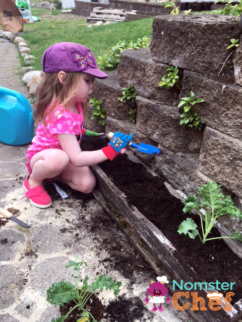 Gardening-with-kids | kids-planting-herbs-2 | Nomster Chef