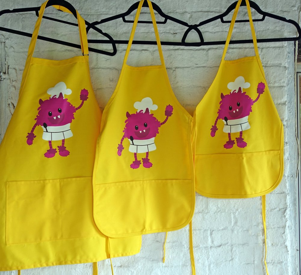 3 apron sizes. From L to R: Adult, Big Kid, Little Kid