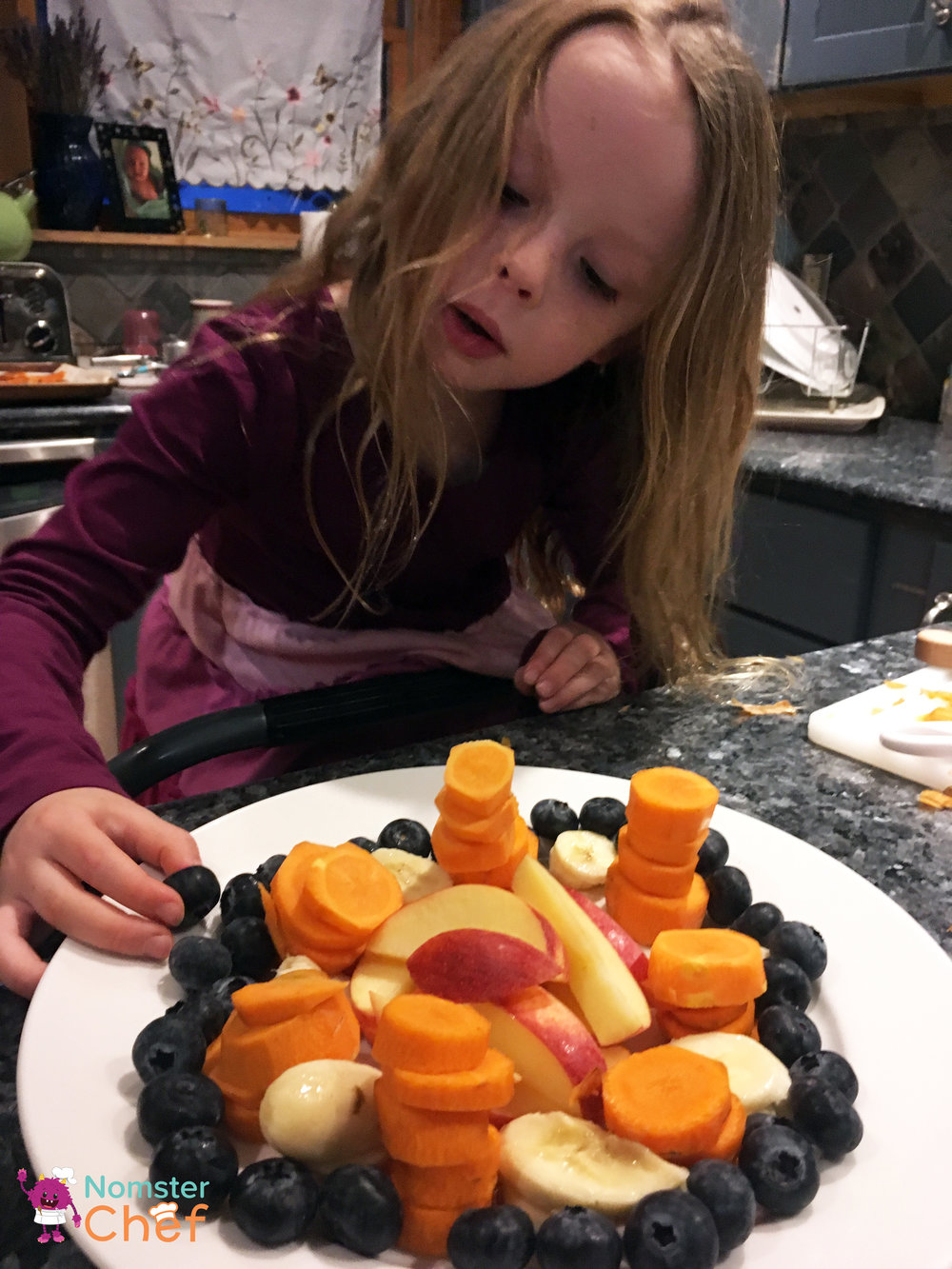 Chef Emma carefully plating her carrot stacks