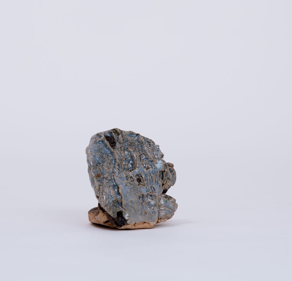 PAUL WACKERS -  Pressed WoodstockStoneware and glaze on stoneware2.5 x 2.5 x 2.5""