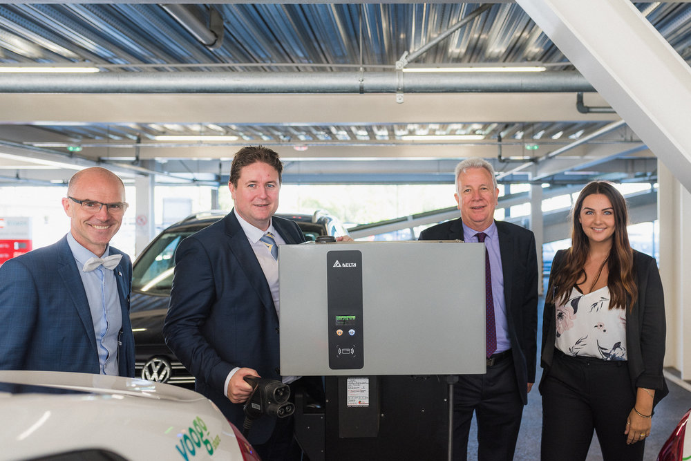 From left: Matty Dinkelmeyer from Delta Australia and YHI's Aaron Gillon, Chris Talbot & Jasmine Roxborourgh with a Delta DC Wallbox installed at Christchurch's West End carpark.