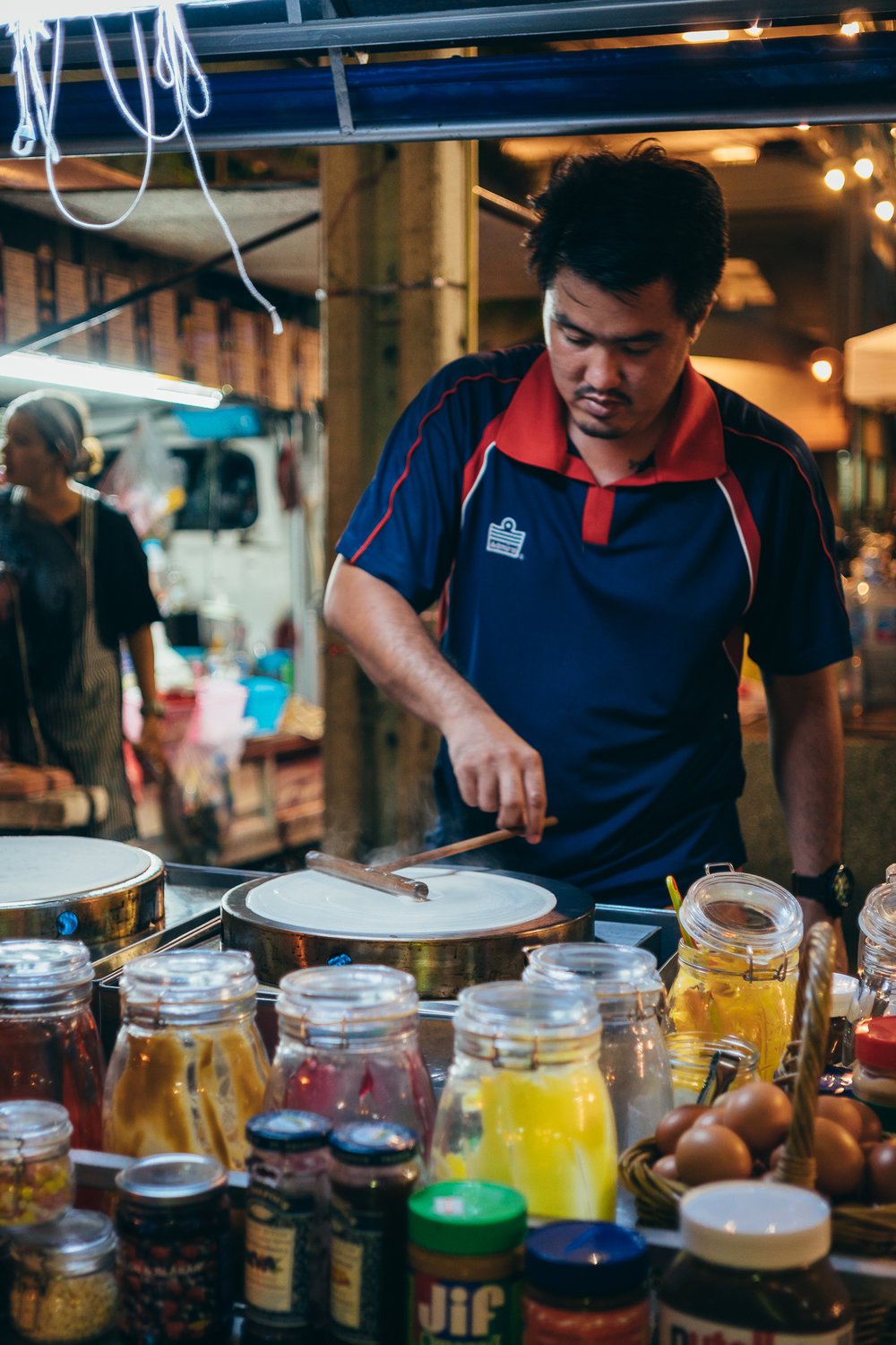 Jay makes the best Crispy Crepes in Bangkok! You can find his stand at Bangkok Bazaar, close to the Saphan Taksin BTS station