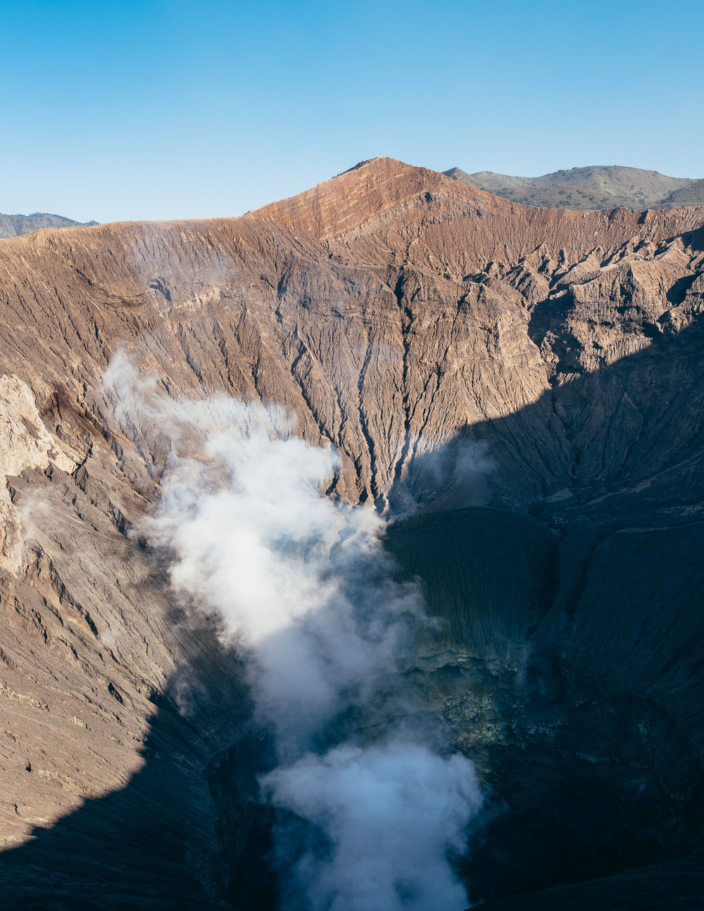 Smoke coming out of the crater.