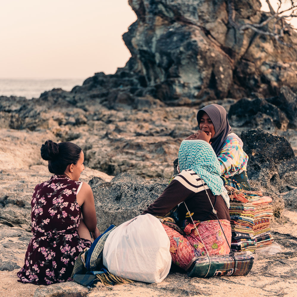 Talking with Lina on one of her breaks after a really long day of work selling sarongs in Lombok, Indonesia.