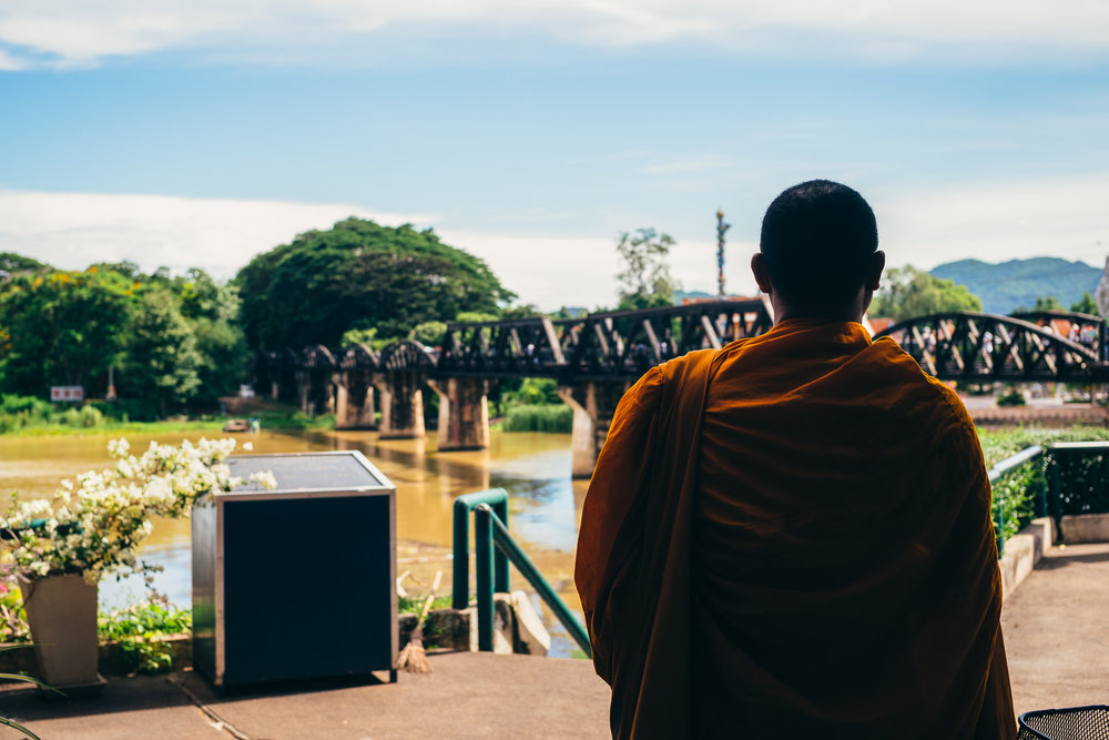 A monk overlooking the Bridge.