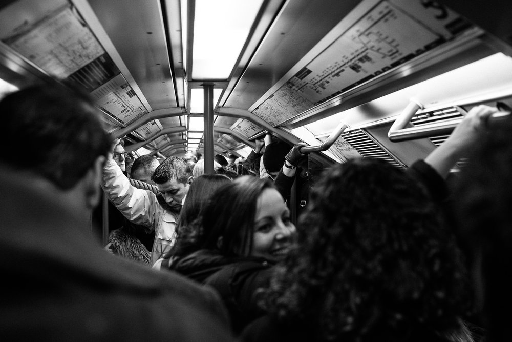 Here's a solid example of the Rule of Thirds, with the subject (man on left-hand side) occupying the first-third of the photograph. This was on the tube during rush hour in London.