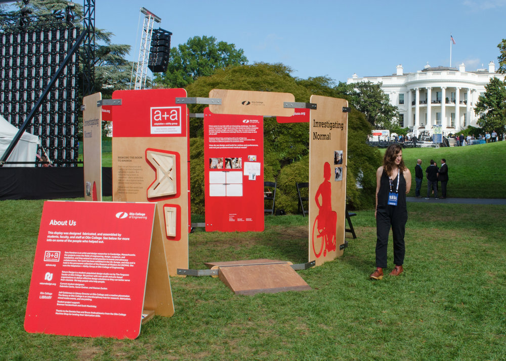 Sara Hendren at the booth with the White house in the background.