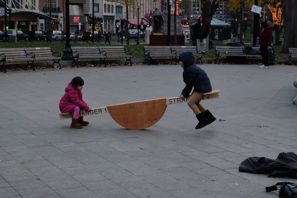 Two young children join in and play.