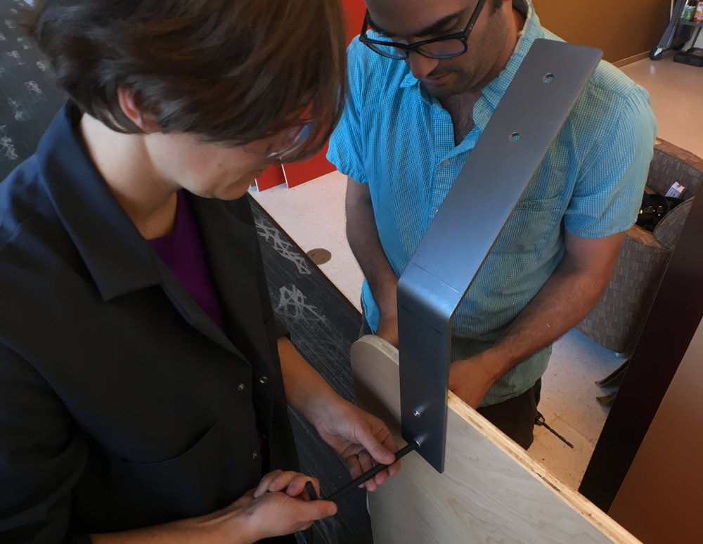 Shop Instructor Daniela and Jeff testing a bracket.