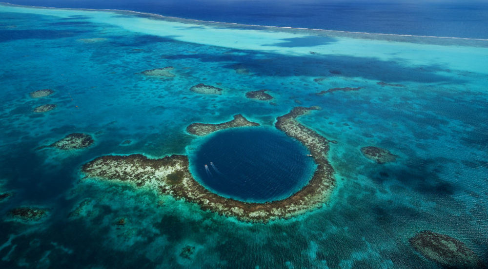 The Blue Hole near Ambergris Caye, Belize. Photo credit:  The Beauty of Travel