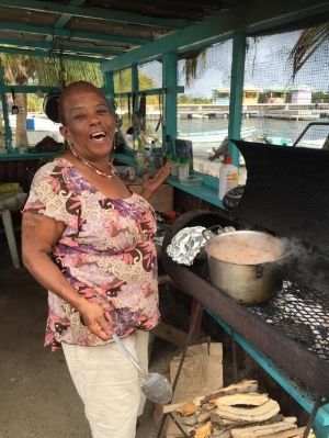 This is Ms. Brenda, making some beans and rice to go with that delicious roadside jerk chicken.