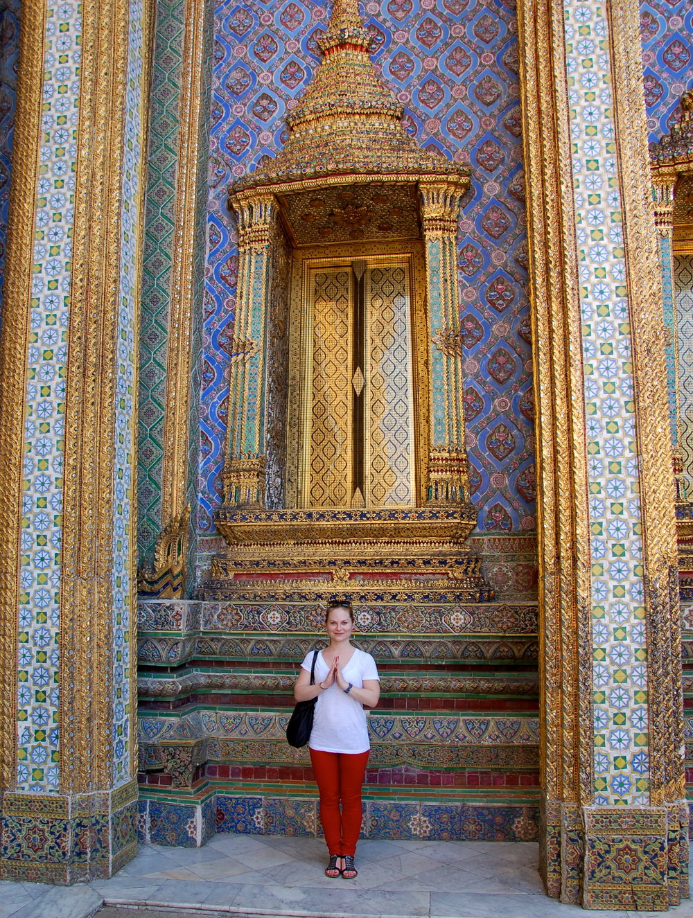 In front of one of the ornate structures at The Grand Palace in Bangkok.