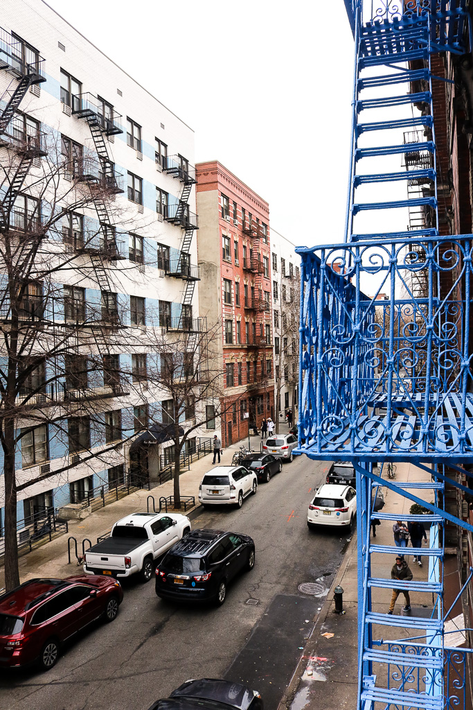 The fire escape views from my bedroom -- how adorable is the blue?