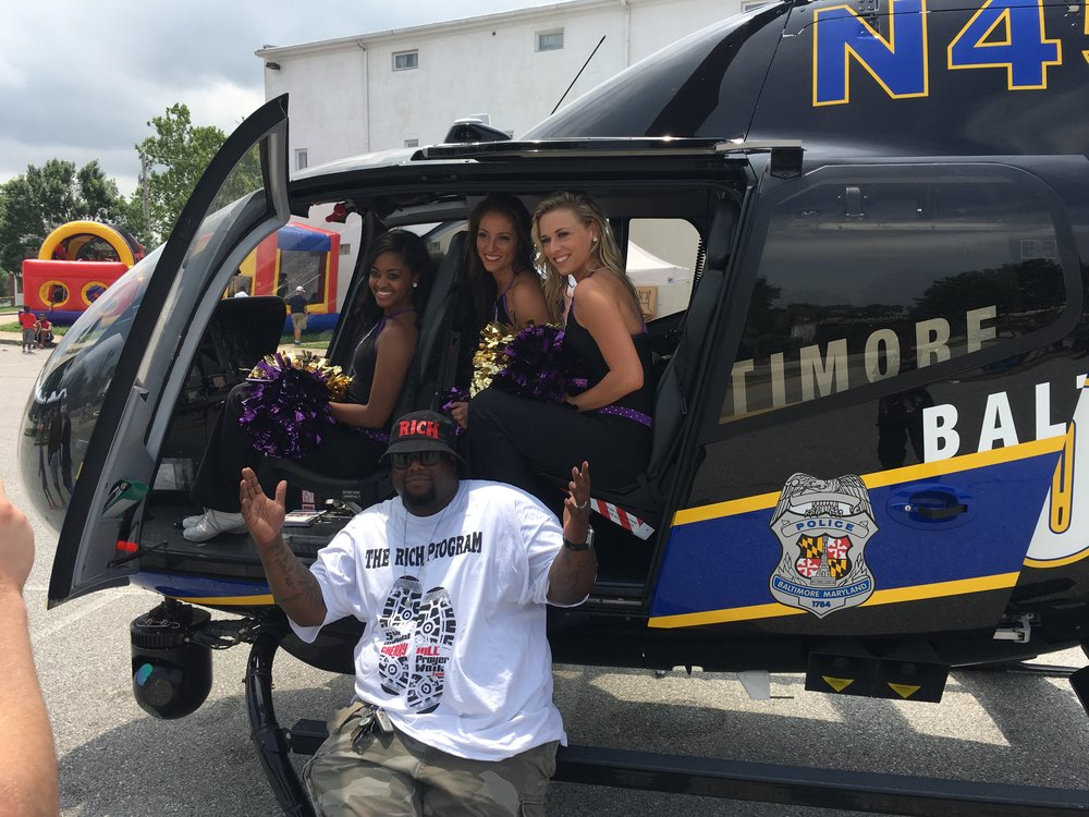 Michael Battle Jr and Baltimore Raven cheerleaders