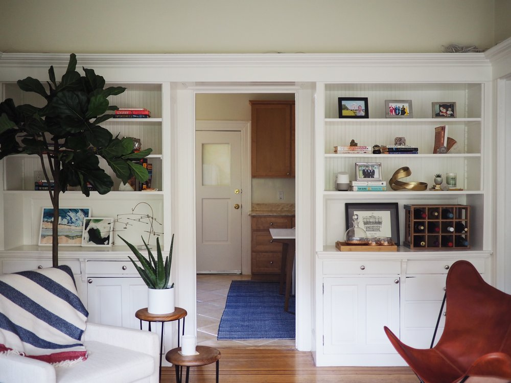 Fiddle leaf fig tree:  World Market . Wood side tables:  The CItizenry . White chair: HD Buttercup (similar:  Target ).