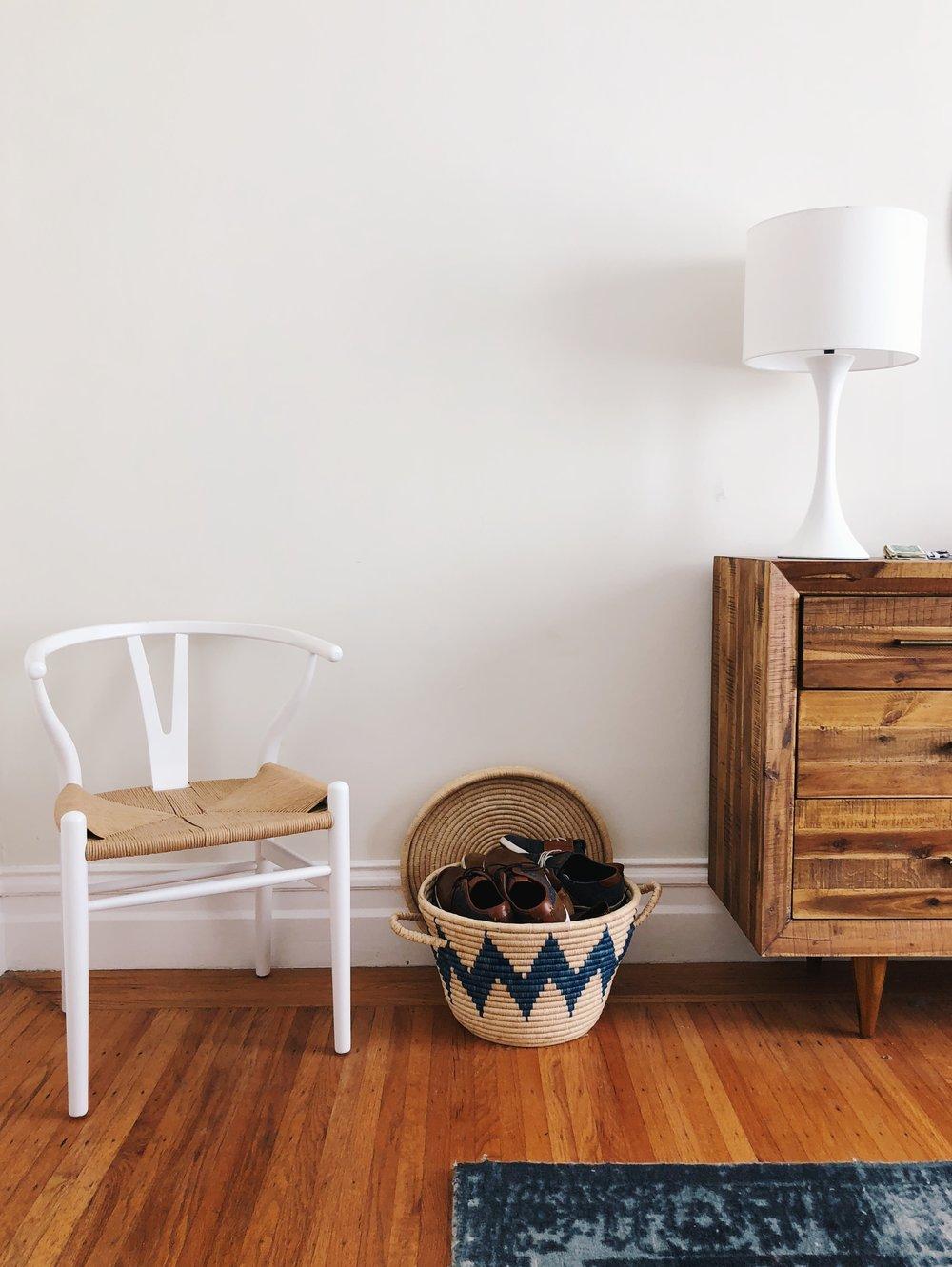 Chair:  Amazon . Basket: The Citizenry ( similar ). Blue rug:  West Elm . Dresser:  West Elm . Lamp:  CB2 .