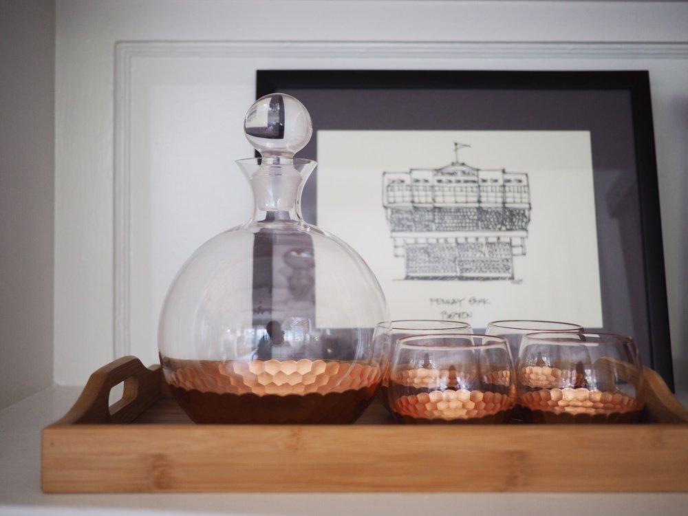 Wood tray:  Amazon . Copper decanter set:  Amazon .